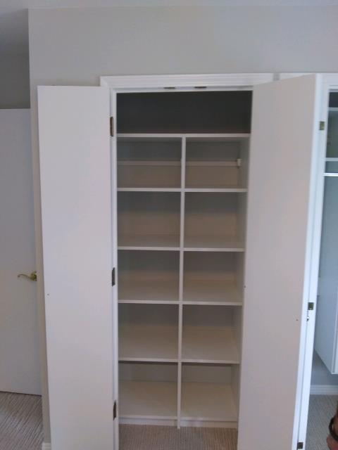 Installation of Bedroom and Linen Closets.