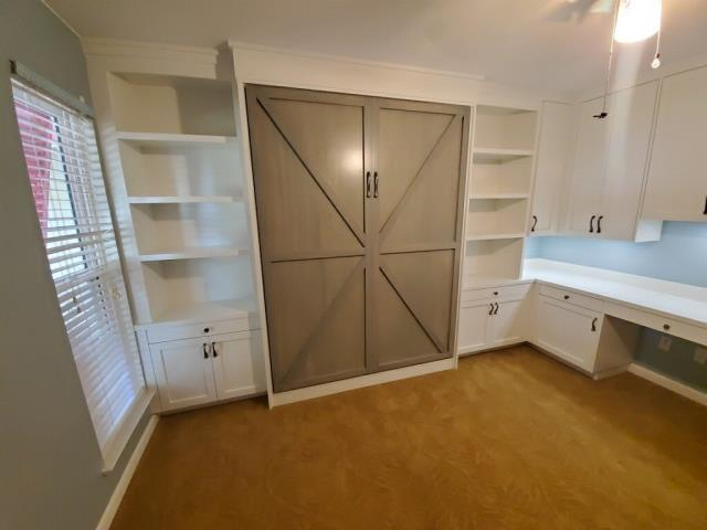 Installation of Murphy Bed, Side Cabinets and Custom Office.