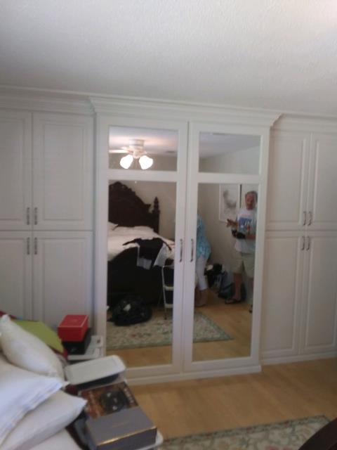 Fabrication and Installation of Closet Cabinet in Master Bedroom with Mirror Doors.