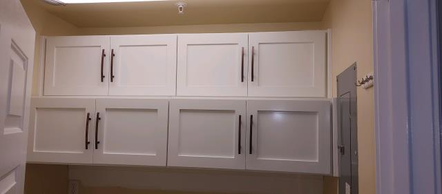 Design, Fabrication and Installation of Upper Utility Room Cabinets. 