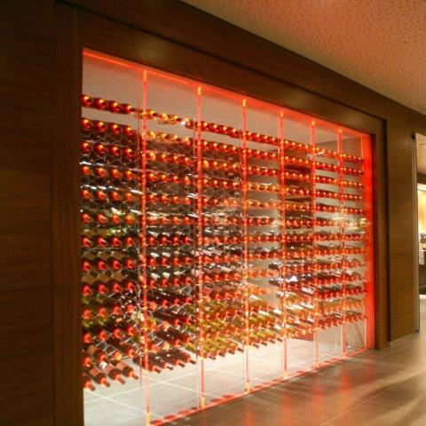 Custom, modular red rack with metal wine racks for an elegant modern look are available.