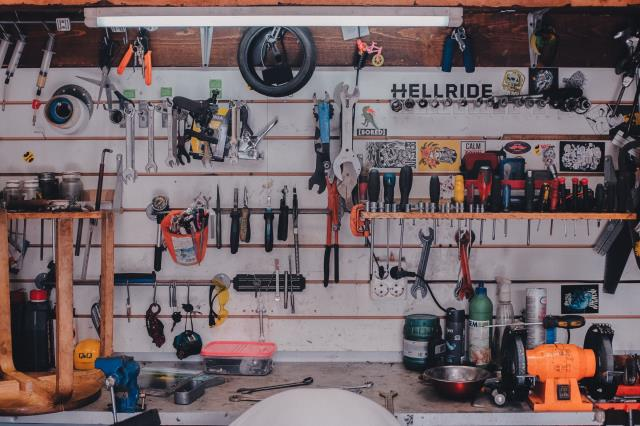 Custom garage storage means you can have the shelves at various sizes and designs, and even have a workbench area included.
