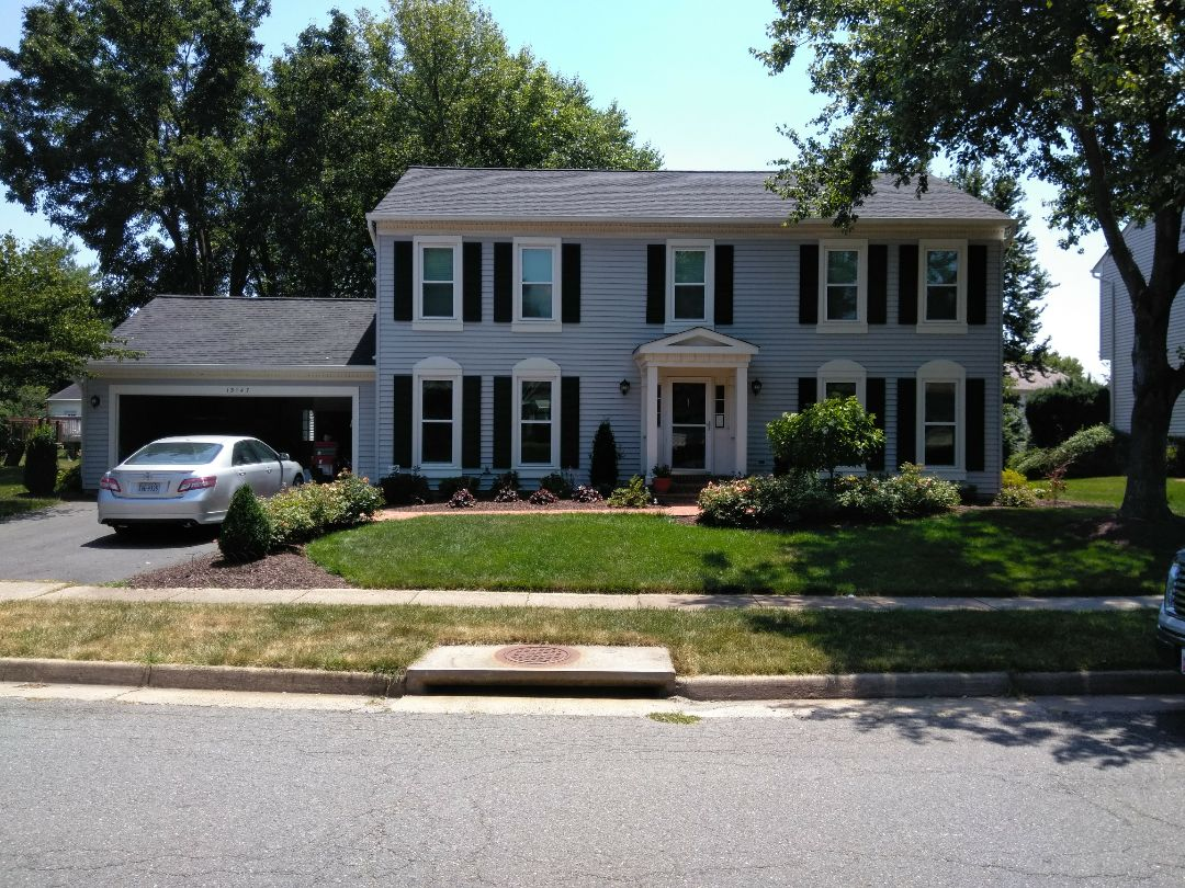 Herndon, VA - High wind and storm damage to the roof's shingles and gutters. We replaced the shingles with CertainTeed Landmark shingles. We replaced the old 5-in gutters with oversized 6-in custom seamless gutters.