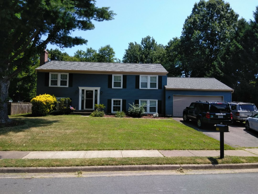 Herndon, VA - High wind and hail caused storm damage to the roofing and siding of the home. We replaced the roof with CertainTeed Landmark shingles. We replaced the siding with Norandex Sagebrush Super Premium vinyl siding.