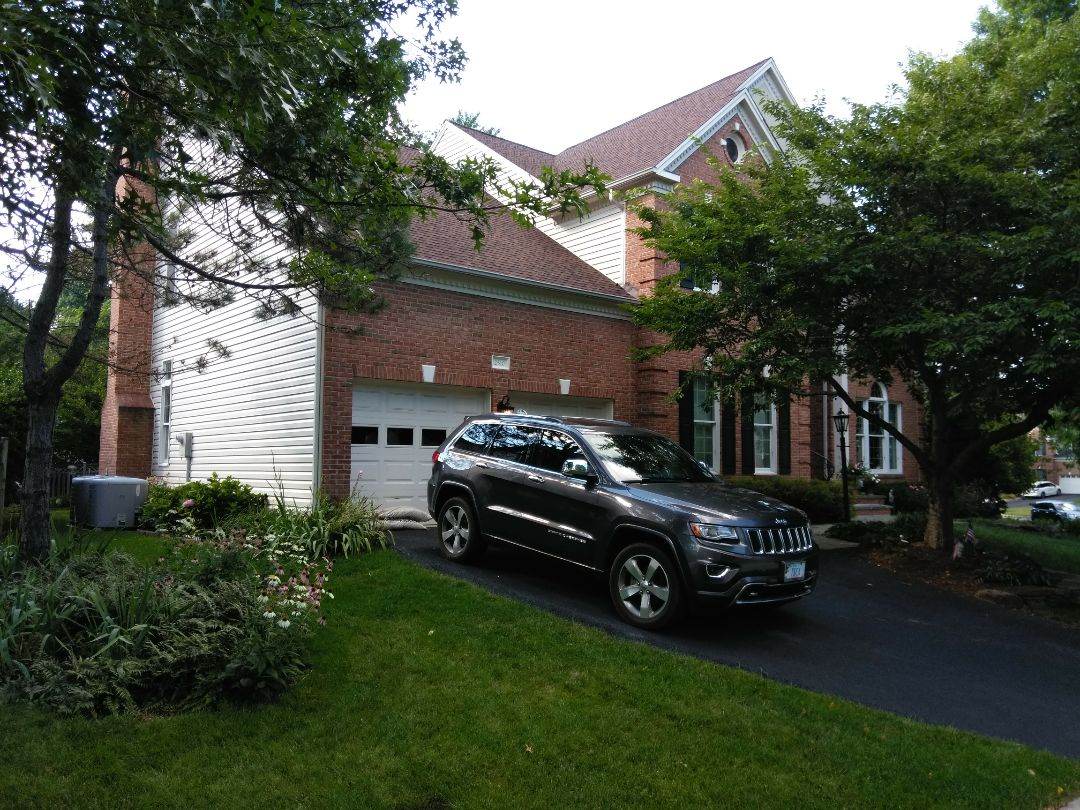 Herndon, VA - Heavy rain, large hail, and strong wind caused damage to the roof's shingles and aluminum siding. We replaced the roof with CertainTeed Landmark architectural shingles. We replaced the aluminum siding with Norandex Sagebrush Super Premium vinyl siding.