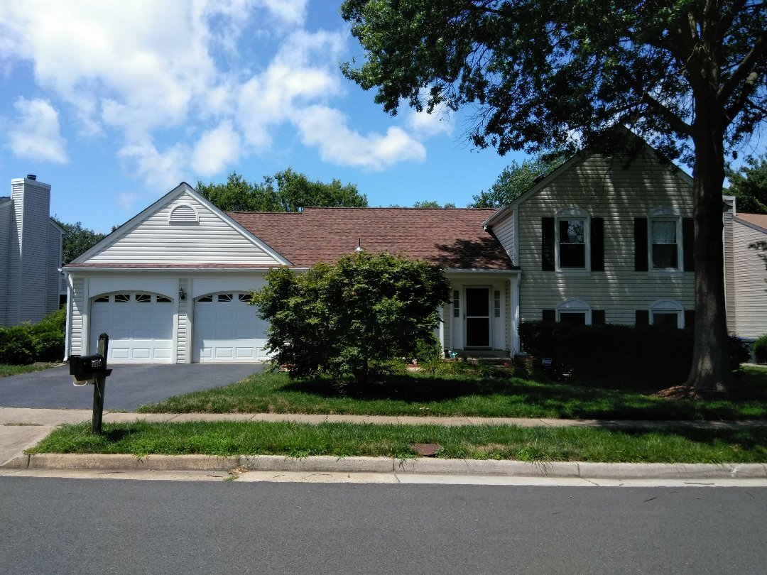 Herndon, VA - Strong storms with heavy rain and gusty winds damaged shingles on the home's roof and its aluminum siding. We replace the roof with CertainTeed Landmark architectural shingles and we replaced the siding with Norandex Sagebrush Super Premium vinyl siding.