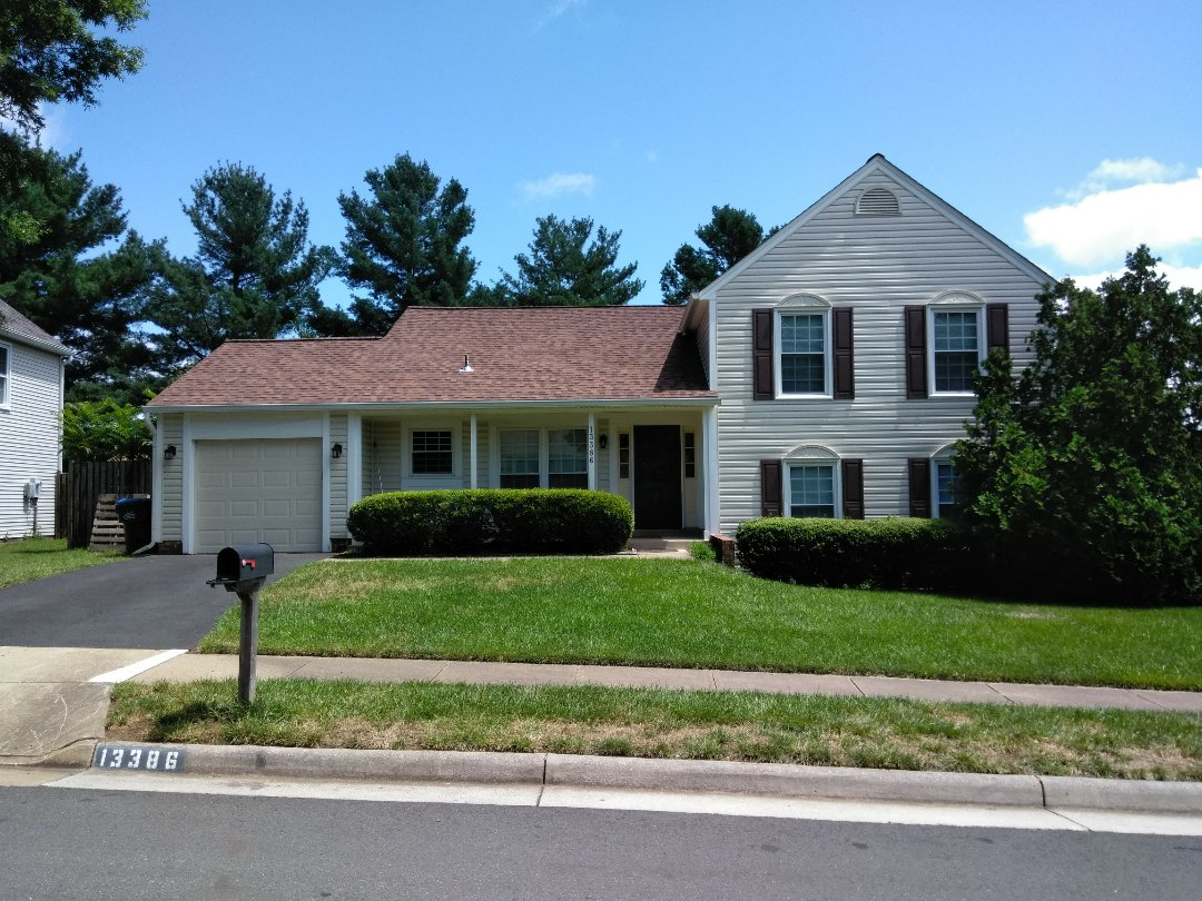 Herndon, VA - High wind and heavy rains tore shingles off the home's roof and damaged the aluminum siding. We replaced the roof with CertainTeed Landmark architectural shingles and we replaced the siding with Norandex Sagebrush .050 Super Premium vinyl siding.