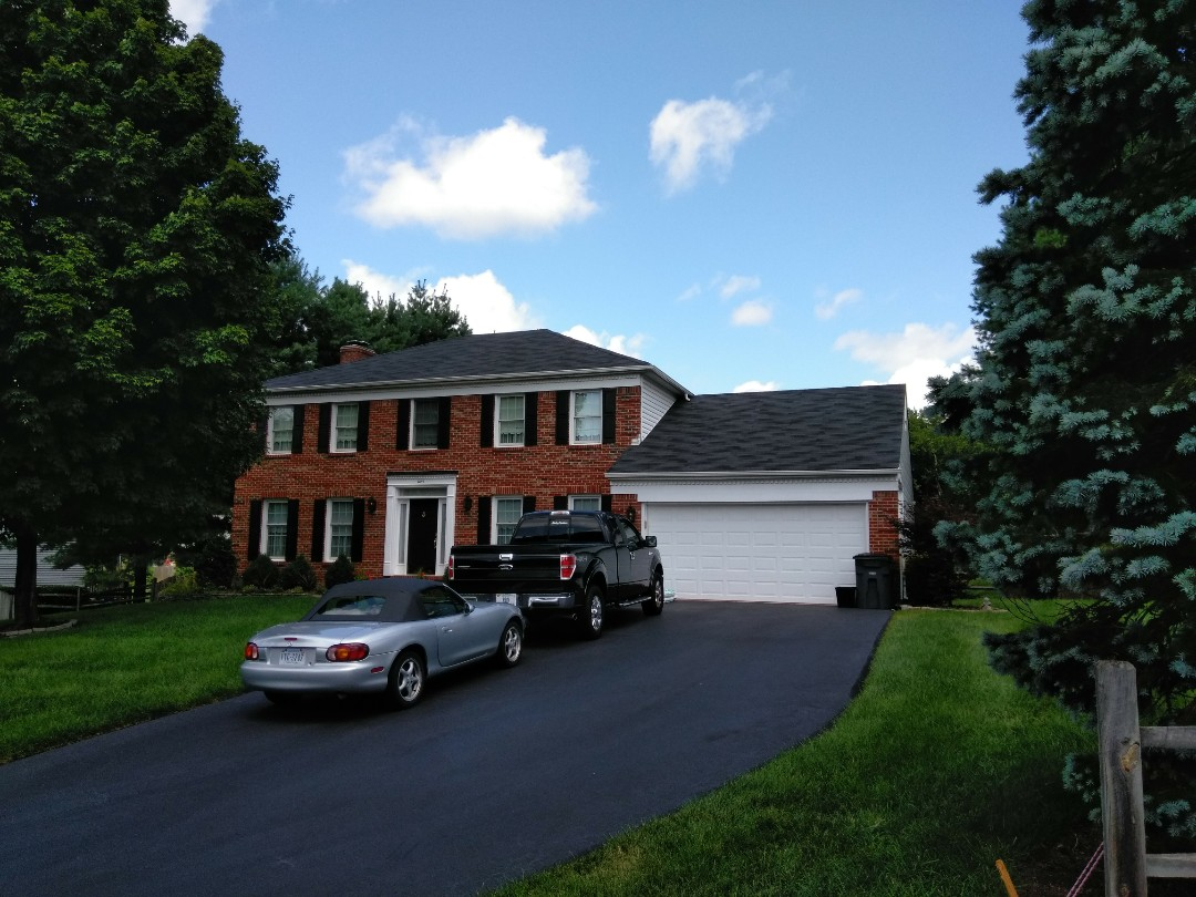 Herndon, VA - High wind and heavy rain damaged the aluminum siding to the home. We replaced the siding with Norandex Sagebrush Super Premium vinyl siding.