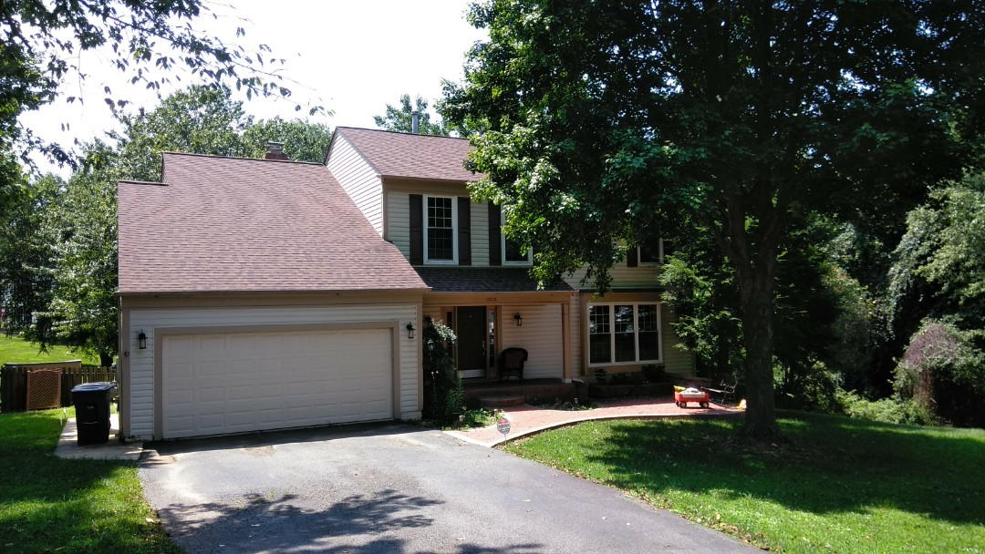 Woodbridge, VA - Large hail and strong winds damaged this home's roof and aluminum siding. We replaced the roof with CertainTeed Landmark architectural shingles and we replaced the siding with Norandex Sagebrush Super Premium vinyl siding.