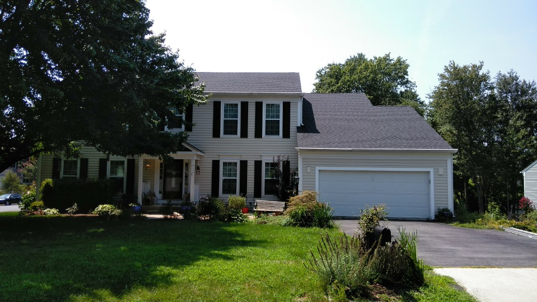 Woodbridge, VA - Large hail with severe winds damaged this home's 3-tab shingled roof and aluminum siding. We replaced the roof with CertainTeed Landmark architectural shingles and we replaced the siding with Norandex Sagebrush Super Premium vinyl siding.