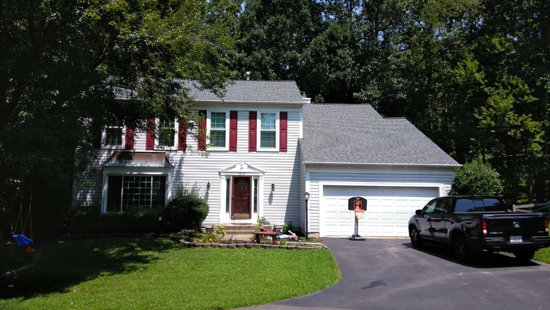 Woodbridge, VA - Severe storms and large hail damaged this home's 3-tab shingled roof and aluminum siding. We replaced the roof with CertainTeed landmark architectural shingles and we replaced the siding with Norandex Sagebrush Super Premium vinyl siding.