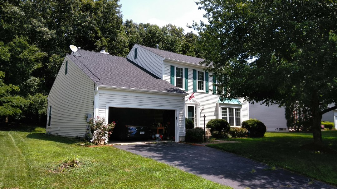 Woodbridge, VA - Severe winds with damaging storms caused numerous shingles to be removed from this 3-tab shingled roof and damaged its aluminum siding. We replaced the roof with CertainTeed Landmark architectural shingles and we replaced the siding with Norandex Sagebrush Super Premium vinyl siding.