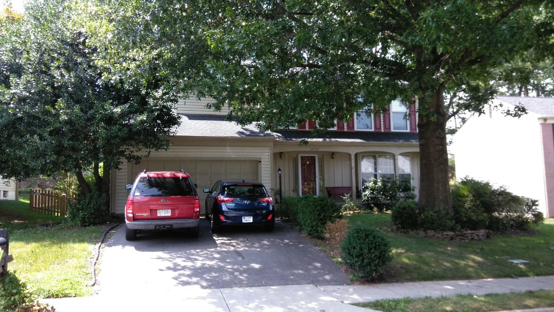 Woodbridge, VA - Severe winds with large hail damage this home's 3-tab shingled roof and aluminum siding. We replaced the roof with CertainTeed Landmark architectural shingles and we replaced the siding with Norandex Sagebrush Super Premium vinyl siding.