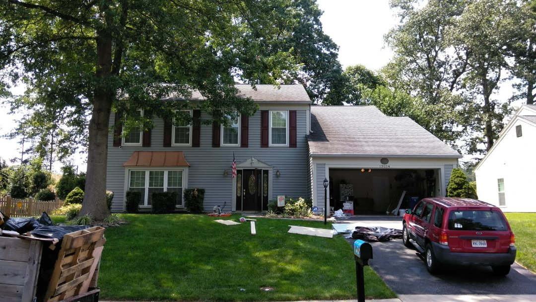 Woodbridge, VA - Large hail and strong winds dented this home's aluminum siding. We replaced the siding with Norandex Sagebrush Super Premium vinyl siding.