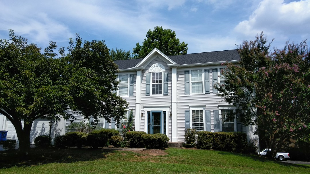 Woodbridge, VA - Strong winds with severe damaging storms tore off numerous shingles on this home's 3-tab shingled roof. We replaced the roof with CertainTeed Landmark architectural shingles.