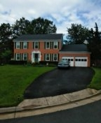 Dale City, VA - Roof replacement from wind damage using CertainTeed Landmark charcoal black architectural shingles.