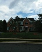 Dale City, VA - Roof replacement from hail damage using CertainTeed Landmark charcoal black architectural shingles.