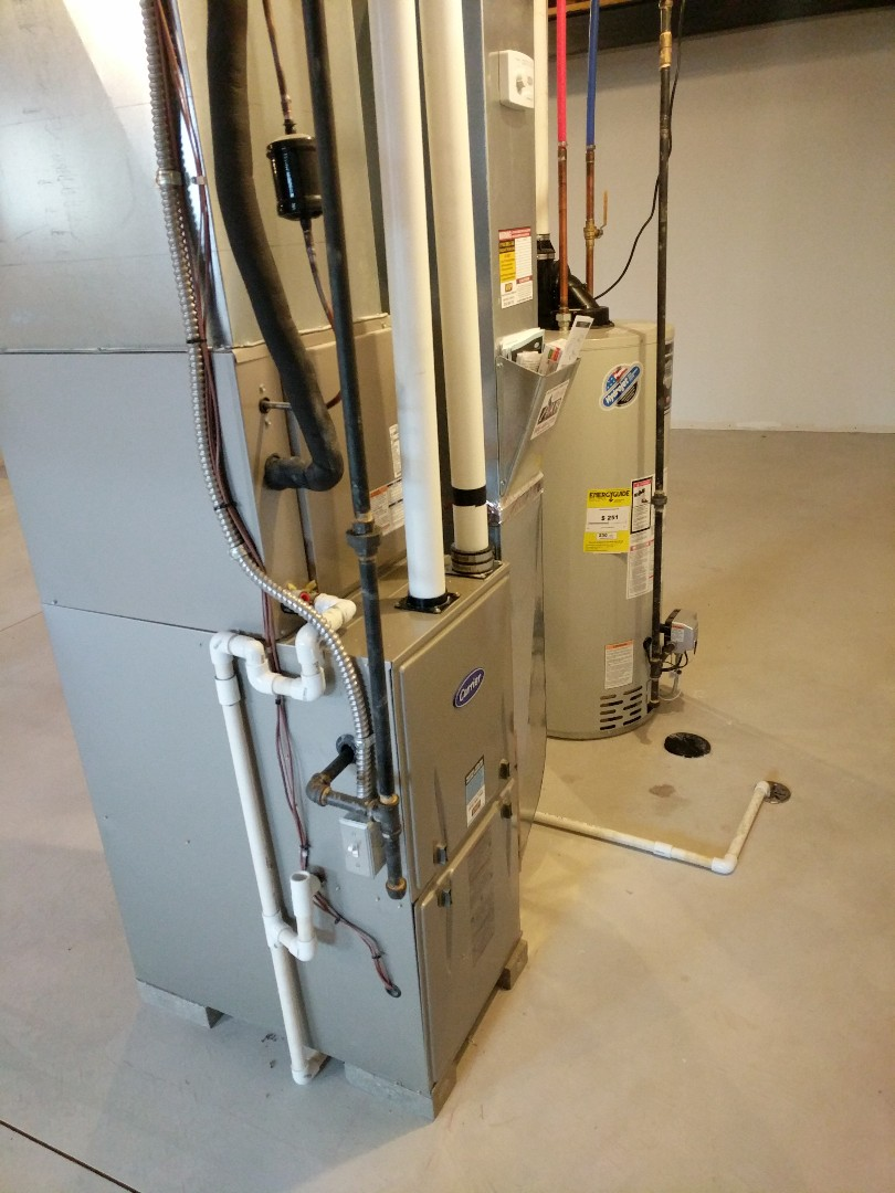 Saint Clair, MI - Carrier furnace clean and check with $50.00 rebate form filled out.
