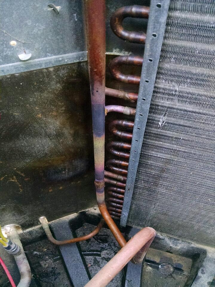 Memphis, MI - repair condenser coil on may tag A/C.