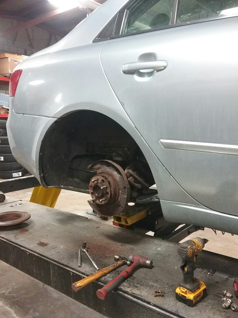 2008 Hyundai Sonata-  replace wheel stud, alignment check, tire rotation,  oil change, 42 point safety inspection,  replace wiper blades