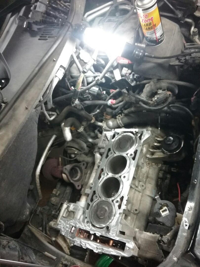 2009 Chevy HHR - remove & replace cylinder head gasket, head bolts, timing chain, timing cover gasket, coolant & heater hoses, radiator cap, transaxle oil cooler pipes, oil change