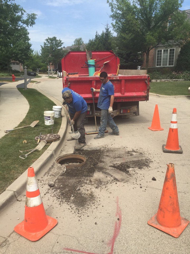Northfield, IL - Working on a storm drain in a driveway.
