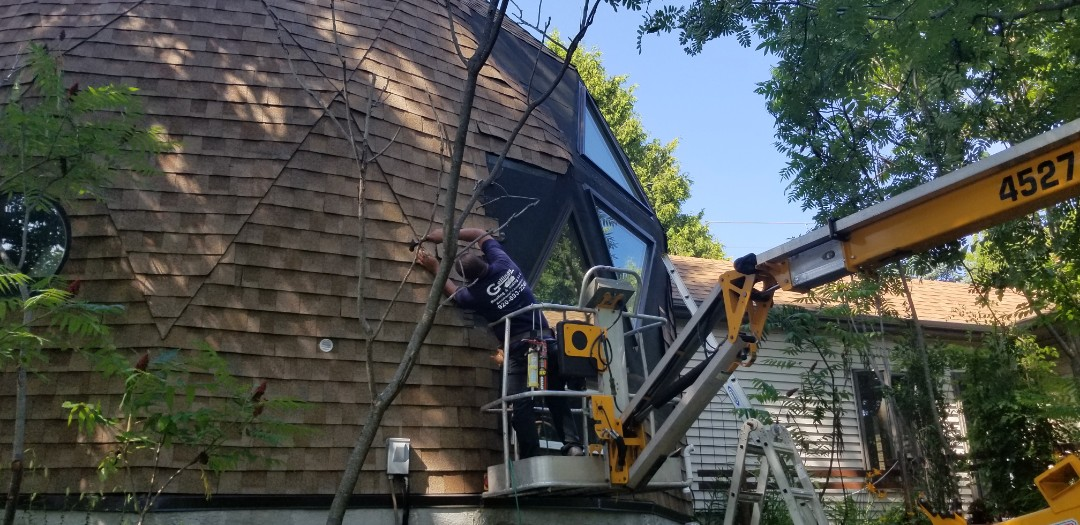 Cleveland, WI - Roofing repair on dome house. Using Owens Corning  Oakridge  Dimensional roofing shingles