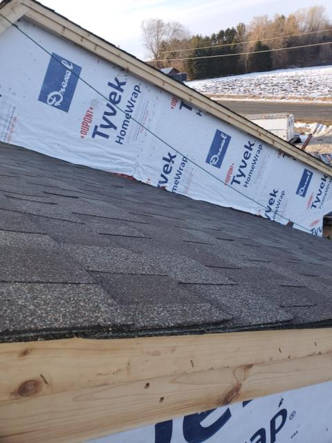 Cedar Grove, WI - Installation of new roof on new construction home . Owens Corning Oakridge  shingle - Driftwood color  For  Bielinski Homes  in  Belguim WI