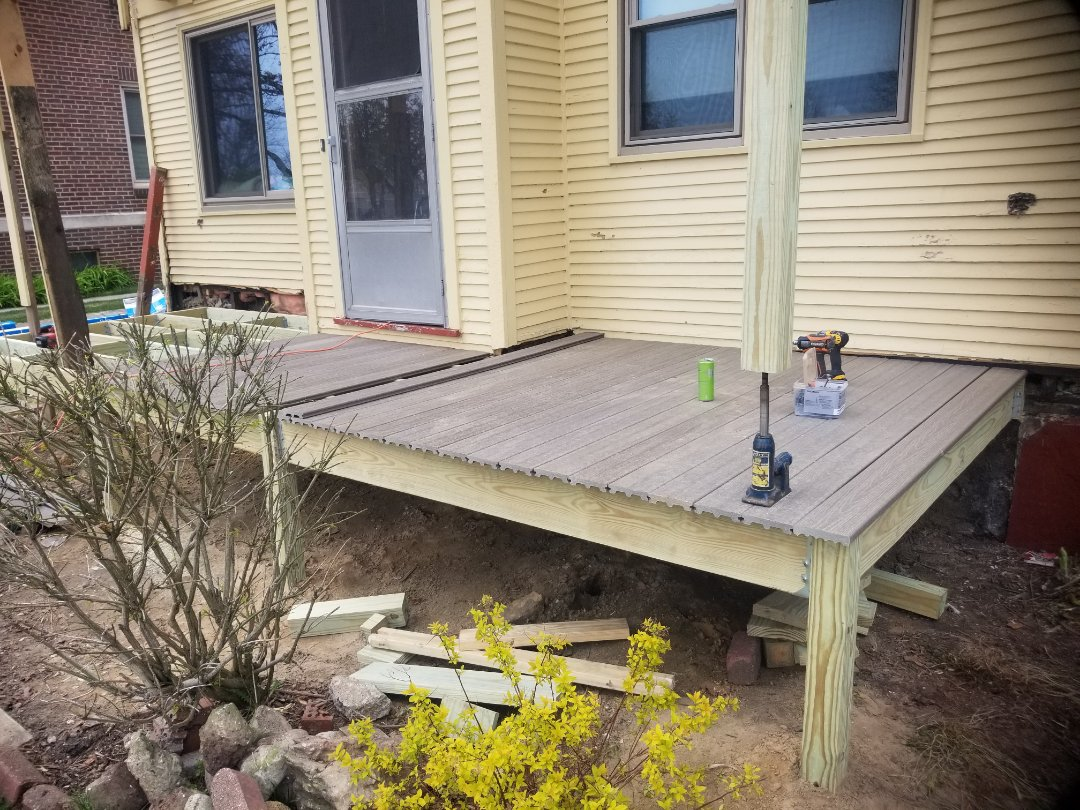 Sheboygan, WI - Porch remodel  Replace stairs  Replace railing  Siding installation  Replace vinyl siding  Vinyl siding installation