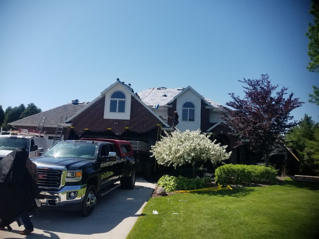 Sheboygan, WI - Roof replacement Sheboygan Wisconsin, roof installation remove and replace roofing shingles, tear off and replace roof shingles with new  Atlas storemaster shake black