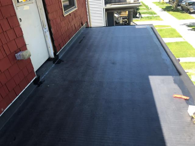 Sheboygan, WI - New Rubber EPDM roofing installed on porch roof  Removed old rolled roofing and installed new rubber membrane roof in Sheboygan WI
