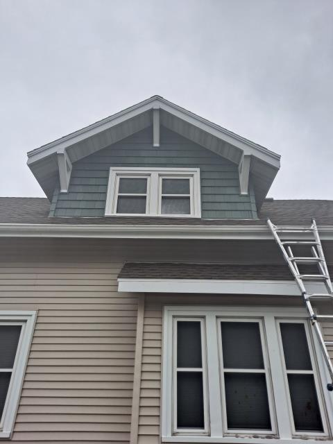 Sheboygan, WI - Vinyl cedar shake replacement on the gables of house  Removed old cedar shake siding shingles and installed new