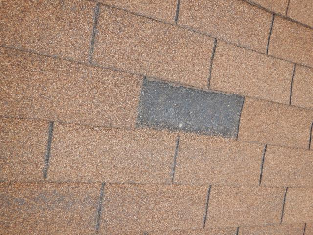 Missing asphalt roof shingle found at the Lake side property. This is sometimes caused by high winds. Home owners should have their roof evaluated annually by a company like ours to check for such defects. Please call us at 760-525-5340 to schedule your roof inspection today.