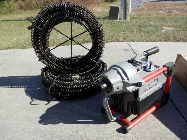 Newnan, GA - Clearing drain line in master bathroom with sewer machine