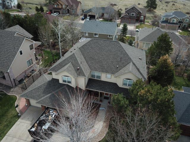 Parker, CO - USAA claim. GCCS removed and replaced this roof with a GAF Timberline HDZ roof system, replaced 22 windows and installed new seamless guttering.