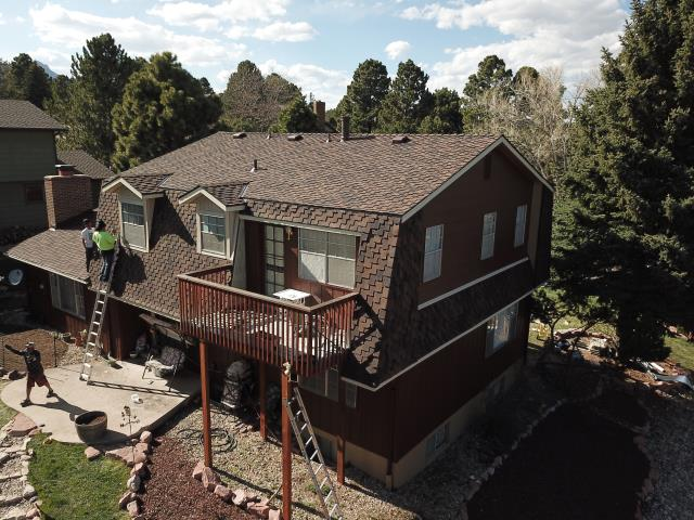 Colorado Springs, CO - Installation of a new Presidential Asphalt roof system, New siding over Window Dormers, Fascia and Soffit repairs