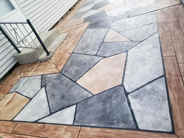 Duluth, GA - Want a unique look for your backyard? Transform your patio with multiple systems! Create a Grand Flagstone patio with a Rustic Wood border, or switch it up with our other systems like Epoxy Flake!