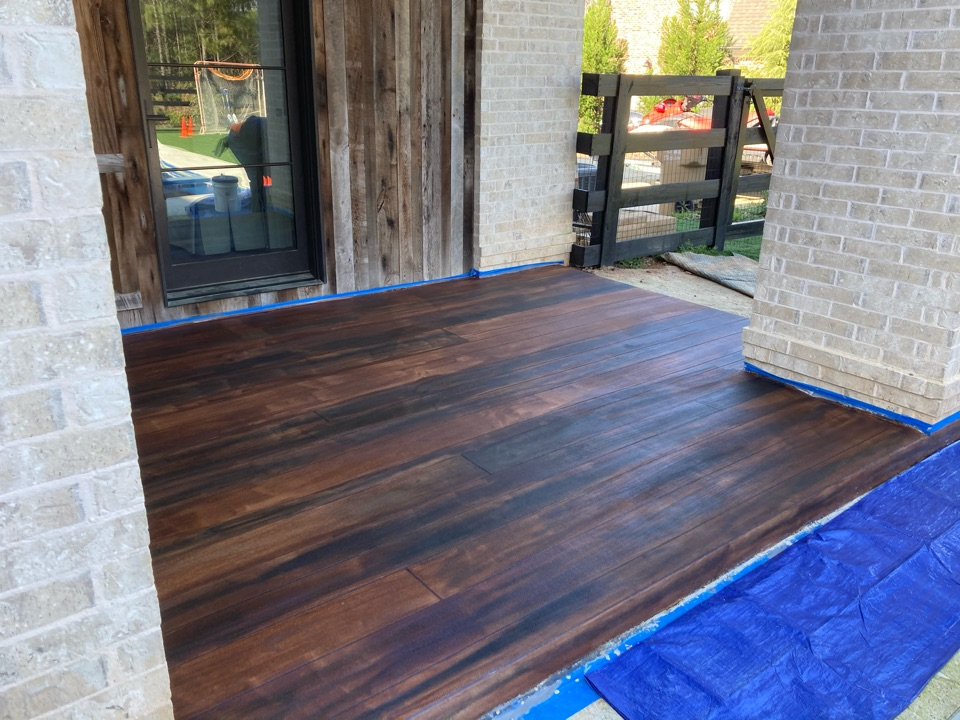 Roswell, GA - Rustic concrete wood covered patio is starting to come together.