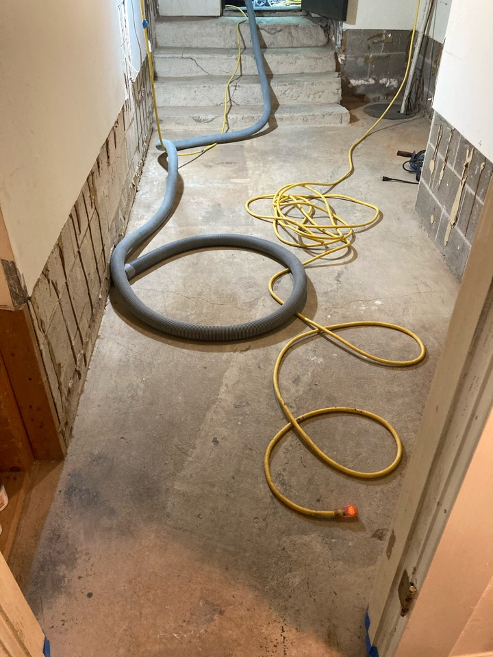 Atlanta, GA - The crew is about to start prepping yet another basement floor for stain.