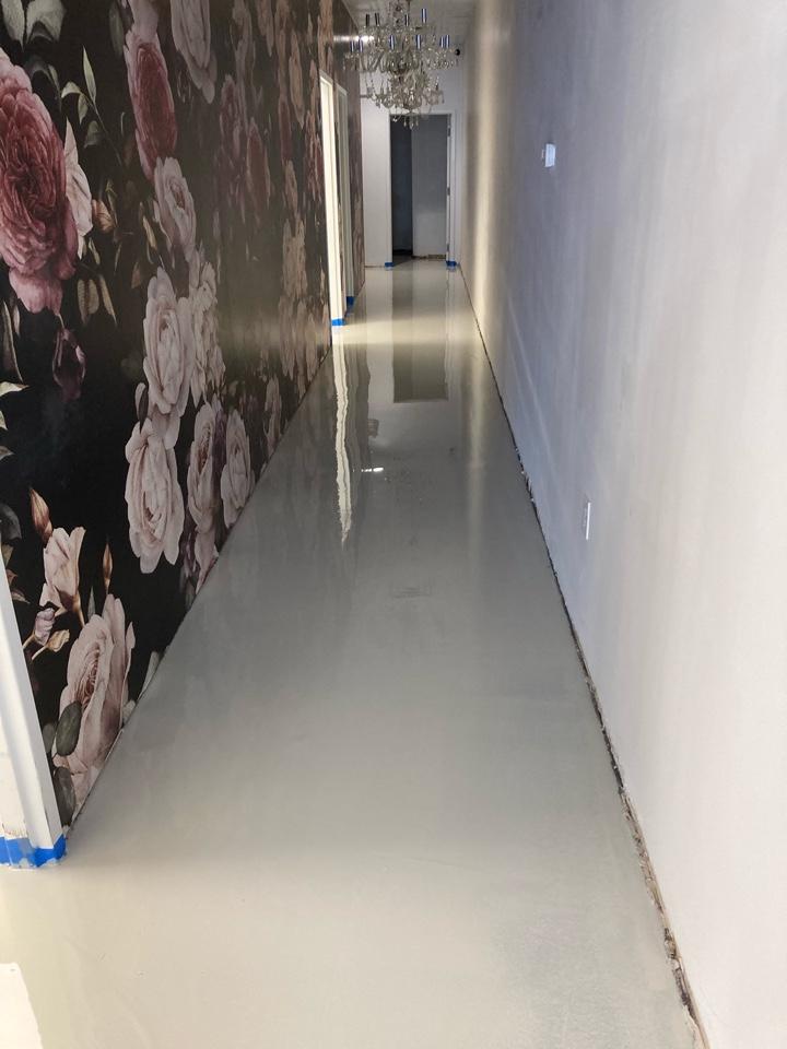 Roswell, GA - Metallic marble epoxy floors going down on this concrete hallway floor. Near Roswell Georgia