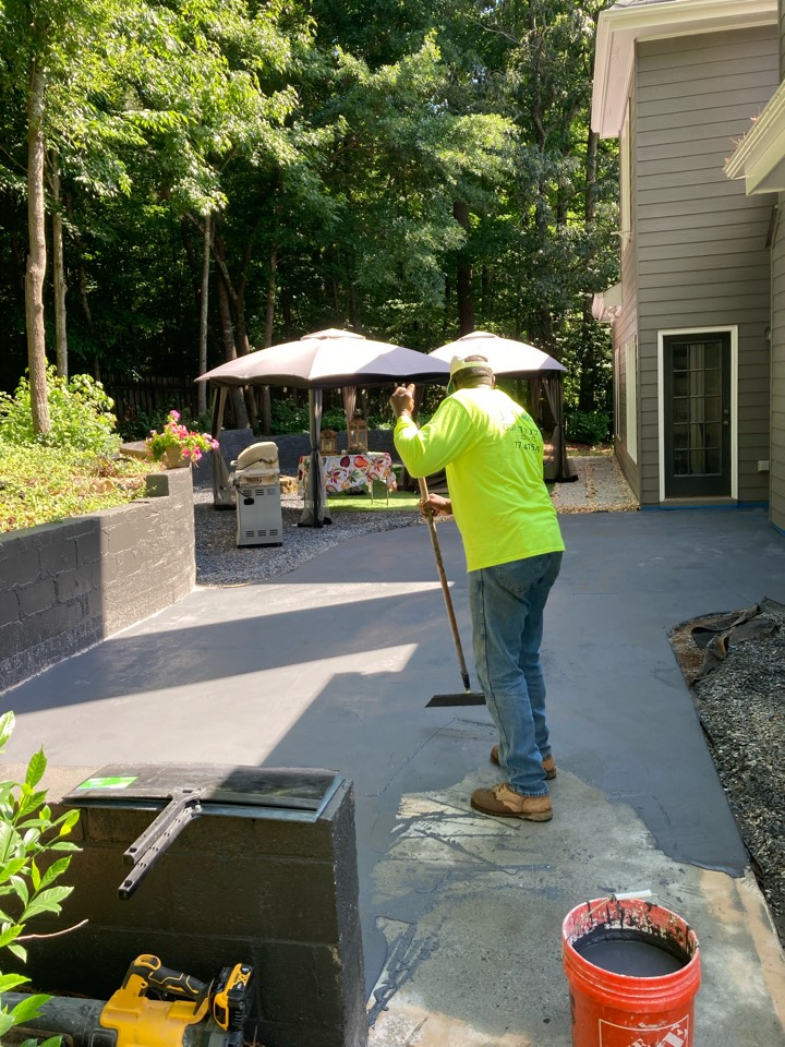 Alpharetta, GA - A grout coat is being installed for our rustic concrete wood on this patio floor! Near Alpharetta Georgia.