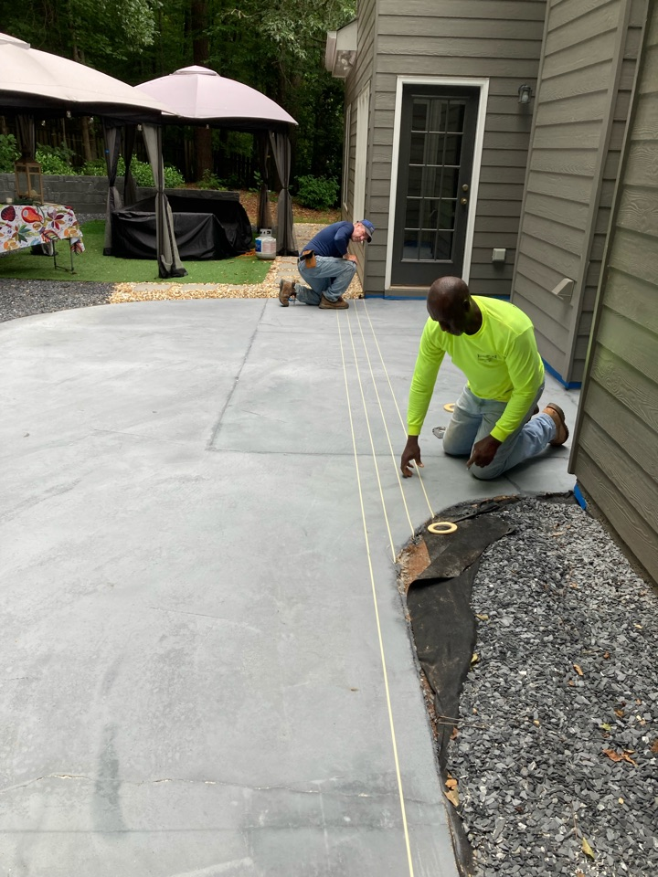 Duluth, GA - This morning we are applying the pattern to this rustic concrete wood patio. Near Duluth Georgia