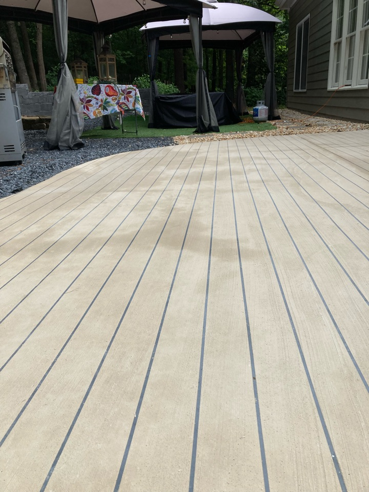 Duluth, GA - We just pulled the tape on this rustic concrete wood patio.  There was a light rain last night so we are going to let it dry for a few hours before applying the stain. Near Duluth Georgia.