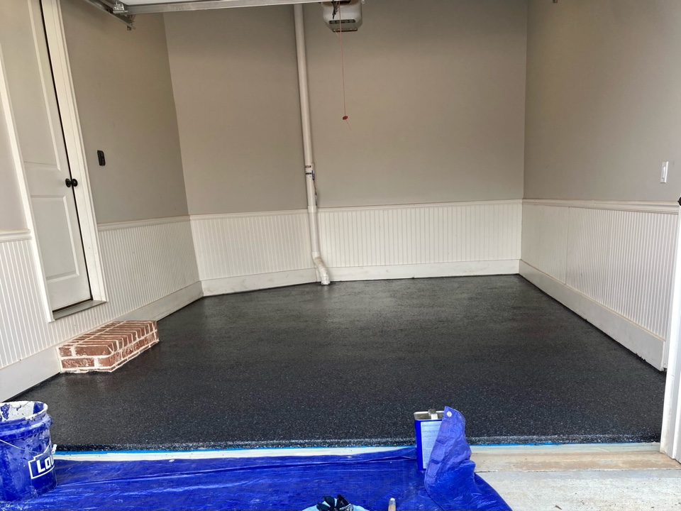 Roswell, GA - The team is starting on this Graniflex flakes garage floor coating near Roswell Georgia