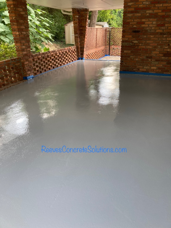 Marietta, GA - We just started the First coat of Permaflex is down on this concrete carport floor.  It will dry for a few hours and then one more coat and we can broadcast the quartz onto the floor. Near Marietta Georgia