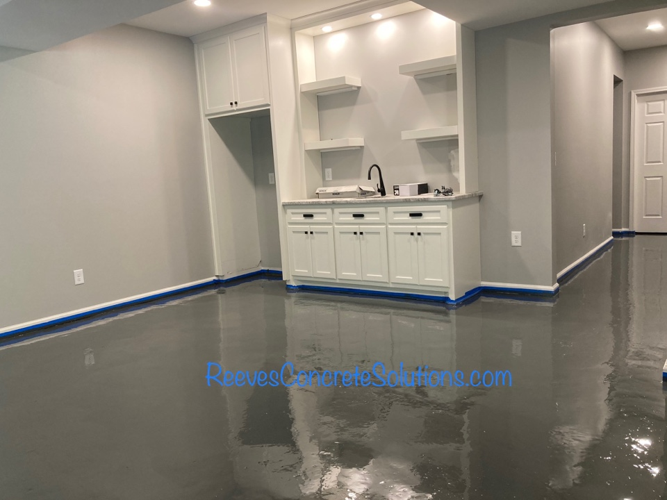 Base coat of epoxy is down on this metallic marble epoxy basement floor.  Tomorrow we will sand, fill any imperfections and begin preparing for the next coat.
