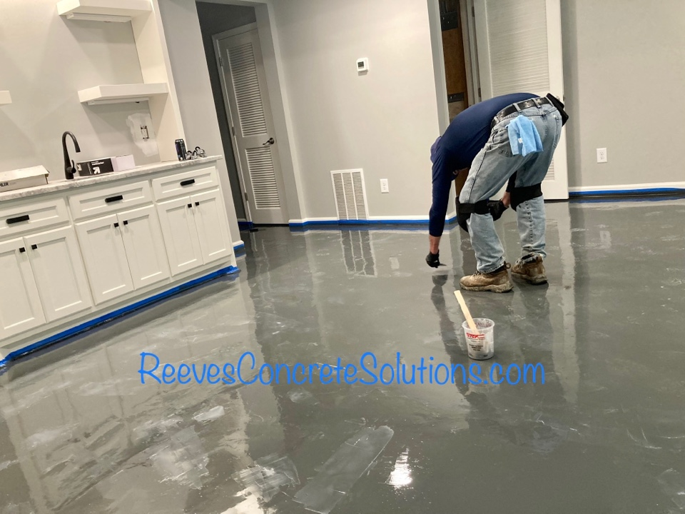Prime coat of epoxy is dry on this metallic marble epoxy basement floor.  Now we are making spot repairs after they cure we will sand and clean before pouring the color coat tomorrow.  This is going to be a bold floor with 5 colors of metallic epoxy.
