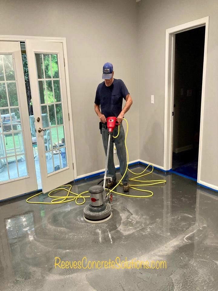 Sanding the prime coat of epoxy getting ready for the metallic coat on this metallic marble epoxy basement floor