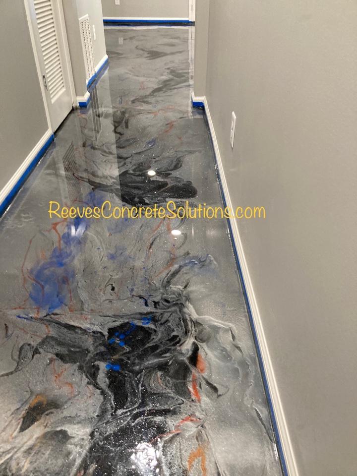 Metallic marble epoxy floor with glitter in this basement.
