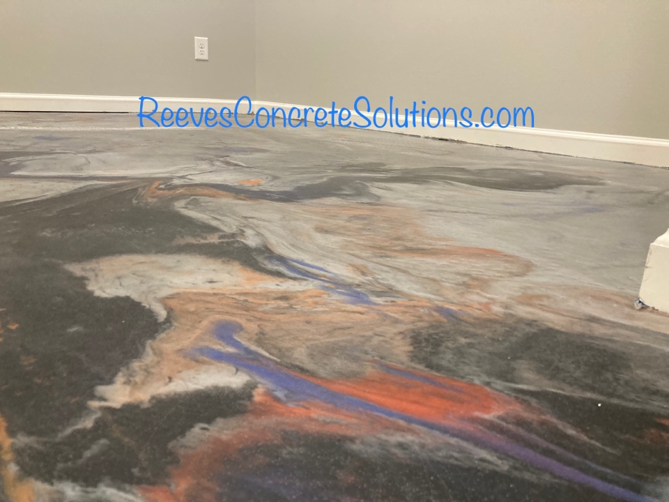 Woodstock, GA - The color combinations and design in our metallic marble epoxy floors are only limited by your imagination.  Tomorrow we will finish up this basement floor that has 5 colors plus glitter embedded in the metallic marble epoxy.